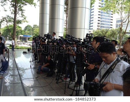 Bangkok, Thailand - March 31, 2014:Photographer and journalists wait interview at the Criminal Court during sentence lawsuit case five senior police officers of abduction and murder Al-Ruwaili. - stock photo