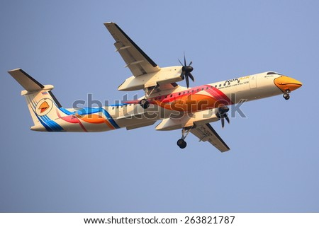 "BANGKOK, THAILAND - March 19, 2015: Q400 NextGen ""Nok Kao Poon"" of Nok Air. landing to Bangkok Donmueang airport from Chiangmai airport - stock photo"