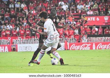 BANGKOK THAILAND - MARCH 17 : Unidentified player in Thai Premier League (TPL) between SCG Muangthong Utd. (red) vs BEC Tero (White) on March 17, 2012 in SCG Stadium in Bangkok Thailand - stock photo
