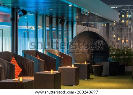 BANGKOK, THAILAND - May 4: Dining chair or sofa on terrace of restaurant  at twilight evening time in Bangkok, Thailand on May 4, 2015 - stock photo