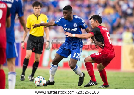 BANGKOK THAILAND MAY 30:Jeramy Boga no.32(blue)of Chelsea in action during the Singha Chelsea fc. Celebration match Thailand All-Stars and Chelsea FC at Rajamangala Stadium on May 30,2015 in Thailand. - stock photo
