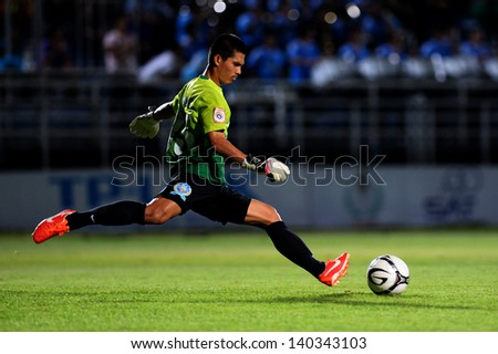 BANGKOK, THAILAND- MAY29:Sornnarai Chamrurai of TOT SC.Goalkeeper hit the ball during   Thai Premier League  between TOT SC and Bangkok Glass F.C. on MAY 29, 2013 at TOT Stadium in Bangkok, Thailand   - stock photo
