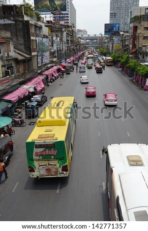 BANGKOK, THAILAND - MAY 30: Traffic moves slowly along a busy road near Platinum Fashion Mall on May 30, 2013 in Bangkok, Thailand. - stock photo
