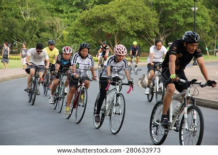 BANGKOK THAILAND - MAY 23 : Unidentified Biker ride a bicycle for exercise on May 23, 2015 at Rama 9 park in Bangkok, Thailand - stock photo