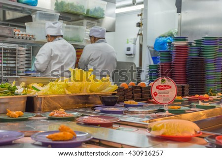 Bangkok, Thailand - May 8, 2016 : Unidentified chefs cooking in the Japan restaurant Kitchen - stock photo