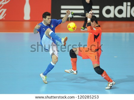 BANGKOK, THAILAND-NOV 18:Alex Merlim of Italy (b) in action during the FIFA Futsal World Cup between Italy and Colombia at Indoor Stadium Huamark on Nov18,2012 in Bangkok,Thailand. - stock photo