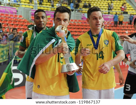 BANGKOK, THAILAND - NOV 18: Falcao of Brazil kisses the trophy after winning the FIFA Futsal World Cup Final at Indoor Stadium Huamark on November 18, 2012 in Bangkok, Thailand. - stock photo