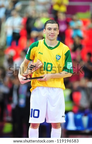 BANGKOK, THAILAND - NOV 18: Fernandinho of Brazil is the adidas Bronze Boot Award after the FIFA Futsal World Cup Final at Indoor Stadium Huamark on November 18, 2012 in Bangkok, Thailand. - stock photo