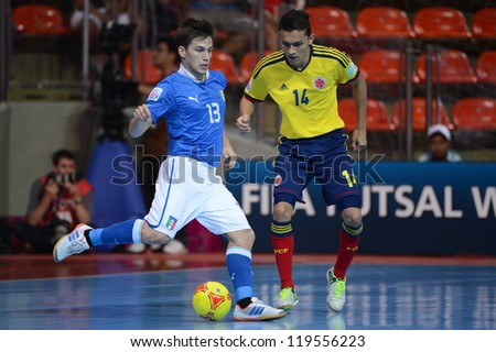BANGKOK,THAILAND-NOV18:Gabriel Lima (blue) of Italy control the ball during the FIFA Futsal World Cup  between Italy and Colombia at Indoor Stadium Huamark on Nov18,2012 in,Thailand. - stock photo