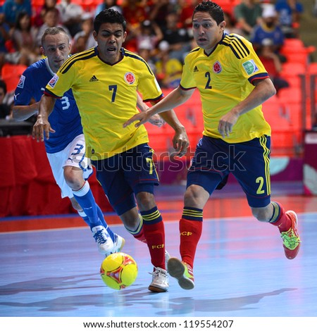 BANGKOK,THAILAND-NOV18: Johann Prado  (no.2) of Colombia control the ball during the FIFA Futsal World Cup  between Italy and Colombia at Indoor Stadium Huamark on Nov18,2012 in,Thailand. - stock photo