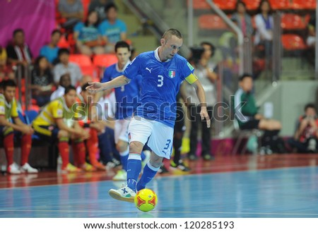 BANGKOK, THAILAND-NOV 18:Marcio Forte of Italy (b) in action during the FIFA Futsal World Cup between Italy and Colombia at Indoor Stadium Huamark on Nov18,2012 in Bangkok,Thailand. - stock photo