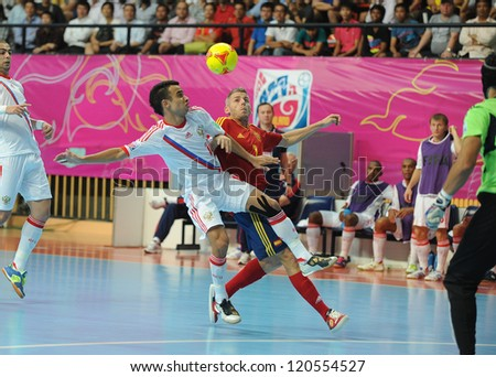 BANGKOK, THAILAND - NOV 14:Miguelin of Spain (r) in action during the FIFA Futsal World Cup Quarterfinal Round between Spain and Russia at Nimibutr Stadium on Nov14,2012 in Bangkok, Thailand. - stock photo