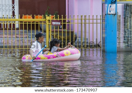 Bangkok - Thailand, Nov 6, 2011: People with their transportation at Ngamwongwan road during a big flooding in Thailand. - stock photo