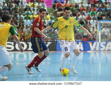 BANGKOK, THAILAND - NOV 18 : Simi (Y) during action in FIFA Futsal World Cup thailand 2012 Between Spain (R) VS Brazil (Y) on November 18, 2012 at Indoor Stadium Huamark in Bangkok Thailand. - stock photo