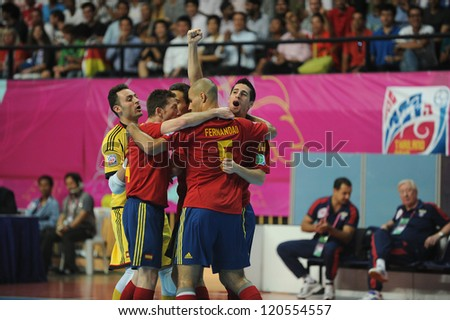 BANGKOK,THAILAND - NOV14:Spain celebrates after scoring during the FIFA Futsal World Cup Quarterfinal Round between Spain and Russia at Nimibutr Stadium on Nov14,2012 in Bangkok, Thailand. - stock photo