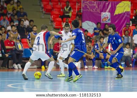 BANGKOK, THAILAND - NOV 1 : Unidentified players in FIFA Futsal World Cup thailand 2012 Between Thailand (B) VS Costa Rica (W) on November 1, 2012 at Indoor Stadium Huamark in Bangkok Thailand. - stock photo
