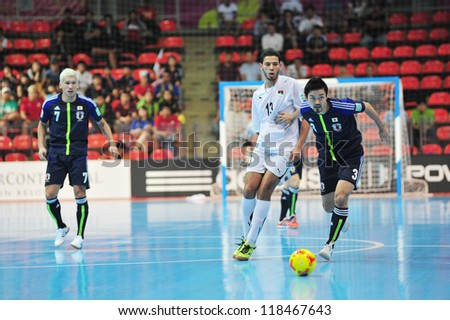 BANGKOK, THAILAND - NOV 7 : Unidentified players in the FIFA Futsal World Cup Group C match between Japan and Libya at Indoor Stadium Huamark on November 7, 2012 in Bangkok, Thailand. - stock photo