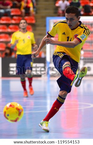 BANGKOK,THAILAND-NOV18: Yeisson Fonnegra  (yellow ) of Colombia shoot the ball during the FIFA Futsal World Cup  between Italy and Colombia at Indoor Stadium Huamark on Nov18,2012 in,Thailand. - stock photo