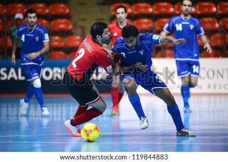 BANGKOK,THAILAND-NOVEMBER 09:Abdulrahman Almosabehi of Kuwait (blue)in action during the FIFA Futsal World Cup between Kuwait and Egypt at Indoor Stadium Huamark on Nov9,2012 in Bangkok,Thailand. - stock photo