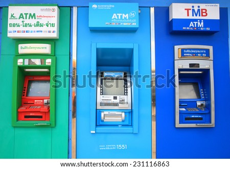 BANGKOK, THAILAND -NOVEMBER 15, 2014:ATM units by different Thai banks, Kasikornbank, Krungthai, and TMB. Most of ATMs in Thailand charge 150 bath fee for withdraw from overseas accounts. - stock photo