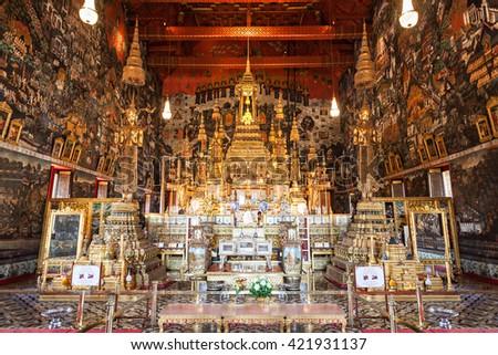 BANGKOK, THAILAND - NOVEMBER 10, 2014: Emerald Buddha statue inside Wat Phra Kaew Temple in Bangkok, Thailand. Wat Phra Kaew is the most sacred Buddhist temple in Bangkok and Thailand. - stock photo