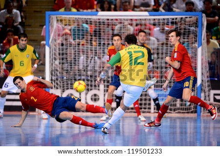 BANGKOK,THAILAND - NOVEMBER18:Falcao (no.12)of Brazil shoot the ball during the FIFA Futsal World Cup Final between Spain and Brazil at Indoor Stadium Huamark on Nov18, 2012 in ,Thailand. - stock photo