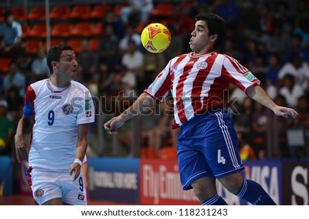 BANGKOK,THAILAND-NOVEMBER 04:Gabriel Ayala (red)of Paraguay for the ball during the FIFA Futsal World Cup between Paraguay and Costa Rica at Indoor Stadium Huamark on Nov4, 2012 in Bangkok, Thailand. - stock photo