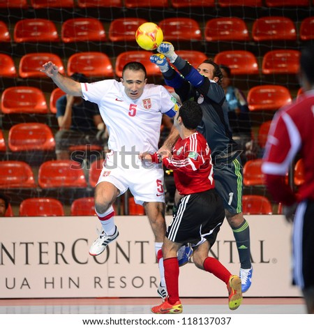 BANGKOK,THAILAND-NOVEMBER03:Goalkeeper Hema(no.1)of Egypt is challenged by Bojan Pavicevic during the FIFA Futsal World Cup between Egypt and Serbia at Indoor Stadium Huamark on Nov3,2012 in Thailand. - stock photo