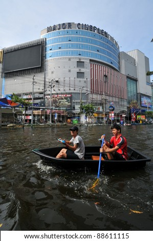 BANGKOK, THAILAND -NOVEMBER 9: Heavy flooding from monsoon rain in Ayutthaya and north Thailand arriving in Bangkok on NOVEMBER 9, 2011 in Bangkok, Thailand. - stock photo