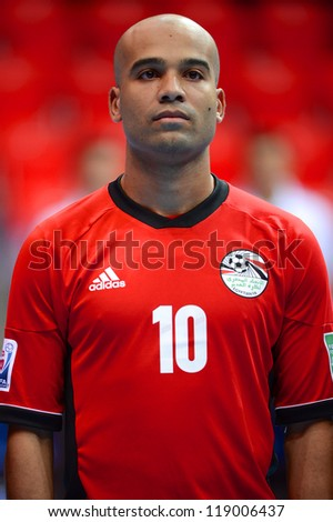 BANGKOK,THAILAND-NOVEMBER 06:Islam El Darwj of Egypt looks on during the national anthem the FIFA Futsal World Cup  between Egypt and Czech Republic at Indoor Stadium Huamark on Nov6,2012 in,Thailand. - stock photo