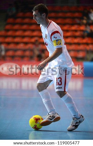 BANGKOK,THAILAND-NOVEMBER06:Islam Gamila of Czech Republic runs with the ball during the FIFA Futsal World Cup  between Egypt and Czech Republic at Indoor Stadium Huamark on Nov6, 2012 in,Thailand. - stock photo