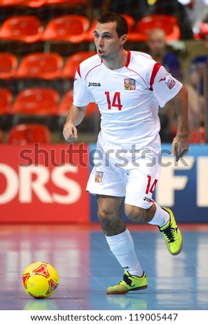 BANGKOK,THAILAND-NOVEMBER06:Jan janovsky of Czech Republic runs with the ball during the FIFA Futsal World Cup  between Egypt and Czech Republic at Indoor Stadium Huamark on Nov6, 2012 in,Thailand. - stock photo