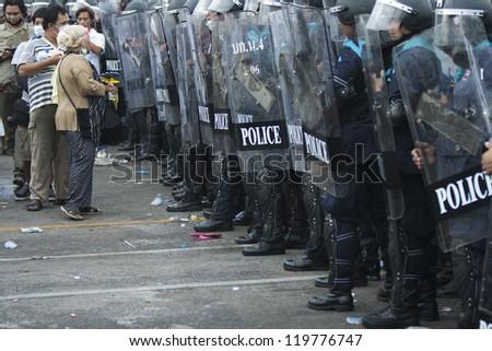 BANGKOK,THAILAND-NOVEMBER,24:Police Commandos guard a barricade on Makkhawan Bridge outside Government HQ on November 24,2012 in Bangkok, Thailand. - stock photo
