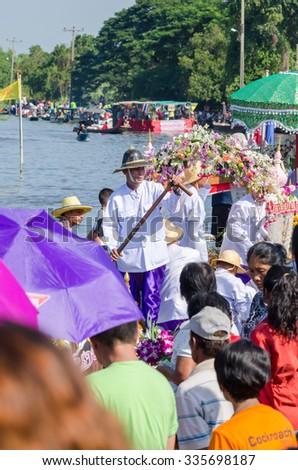 BANGKOK,THAILAND-November 1,2015 : Thai people donate flower and money to a Buddhism on Ok Phansa day(End of Buddhist Lent) in Ladkrabang, Bangkok,Thailand - stock photo