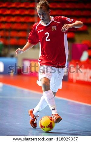 BANGKOK,THAILAND-NOVEMBER 3:Tomas Koudelka of Czech Republic control the ball during the FIFA Futsal World Cup between Czech Republic and Kuwait at Indoor Stadium Huamark on Nov3, 2012 in Thailand. - stock photo