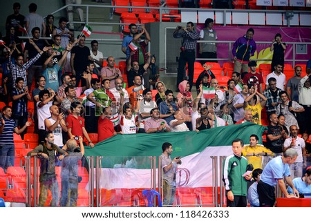 BANGKOK,THAILAND-NOVEMBER 05:Unidentified Fans of Iran celebrate during the FIFA Futsal World Cup between Morocco and Iran at Indoor Stadium Huamark on Nov5, 2012 in Bangkok,Thailand. - stock photo