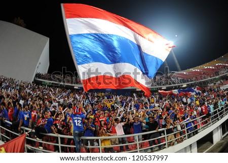 BANGKOK THAILAND-NOVEMBER 30:Unidentified of Thailand Flag supporters during the AFF Suzuki Cup between Vietnam and Thailand at Rajamangala stadium on Nov30, 2012 in Bangkok,Thailand. - stock photo