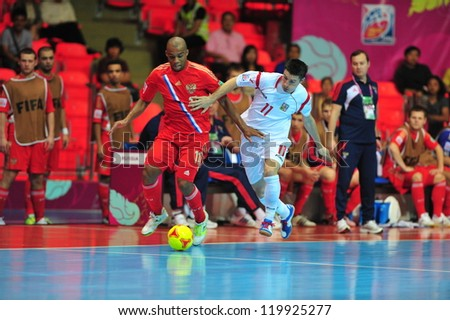 BANGKOK, THAILAND - NOVEMBER 12: Unidentified players in FIFA Futsal World Cup Round of 16 match between Russia and Czech Republic at Indoor Stadium Huamark on November 12, 2012 in Bangkok, Thailand. - stock photo