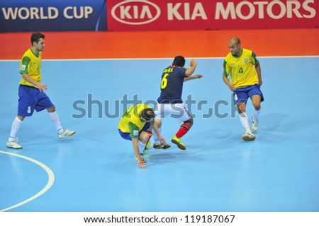 BANGKOK, THAILAND - NOVEMBER 16:Unidentified players in FIFA Futsal World Cup, Semi-Final match between Brazil and Colombia at Indoor Stadium Huamark on November 16, 2012 in Bangkok, Thailand. - stock photo