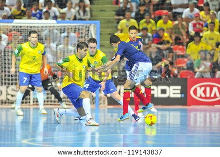 BANGKOK, THAILAND - NOVEMBER 16: Unidentified players in the FIFA Futsal World Cup Semi-Final match between Brazil and Colombia at Indoor Stadium Huamark on November 16, 2012 in Bangkok, Thailand. - stock photo