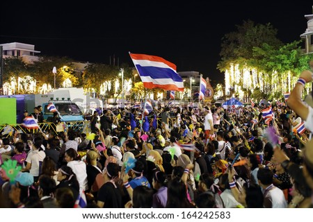 BANGKOK,THAILAND- NOVEMBER 24 : Unidentified protesters protest  against the government corruption and the taksinism at the democracy Monument. on November 24,2013 in Bangkok,Thailand. - stock photo