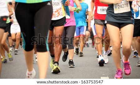 BANGKOK, THAILAND - NOVEMBER 17: Unidentified runners at Standard Charterd Bangkok Marathon 2013 running championship for 42, 21, 10 Km. on November 17, 2013 in Bangkok, Thailand  - stock photo