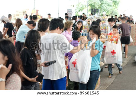 BANGKOK, THAILAND-NOVEMBER 27: Volunteers to help line up the bag to help the victims after the heaviest monsoon rain in 50 years in the capital on November 27, 2011 , Red Cross Bangkok, Thailand. - stock photo