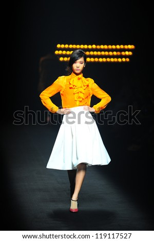 "BANGKOK, THAILAND - OCT 12 : Model walks the runway at "" Theatre "" collection presentation during ELLE Fashion Week 2012 on October 12, 2012 in Bangkok Thailand. - stock photo"