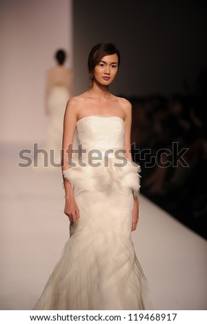 "BANGKOK, THAILAND - OCT 12 : Model walks the runway at "" VATIT ITTHI "" collection presentation during ELLE Fashion Week 2012 on October 12, 2012 in Bangkok Thailand. - stock photo"