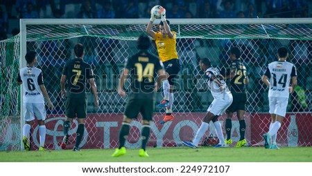 BANGKOK THAILAND-Oct15:Sinthaweechai Hathairattanakool(Y)of Chonburi F.C.in action during Thai Premier League Army United F.C.and Chonburi F.C.at Royal Thai Army Stadium on October15,2014 in Thailand - stock photo
