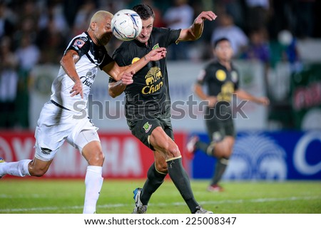 BANGKOK THAILAND-Oct15:Thiago Cunha(w)of Chonburi F.C.compete for the ball during  Thai Premier League Between Army Utd F.C.and Chonburi F.C.at Royal Thai Army Stadium on October15,2014 in Thailand - stock photo