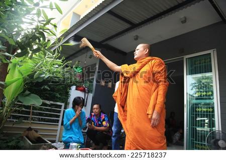 BANGKOK, THAILAND - OCTOBER 12: Buddhist monk praying, Thailand on October 12, 2014, buddhist monks praying for to a housewarming in Bangkok, Thailand - stock photo