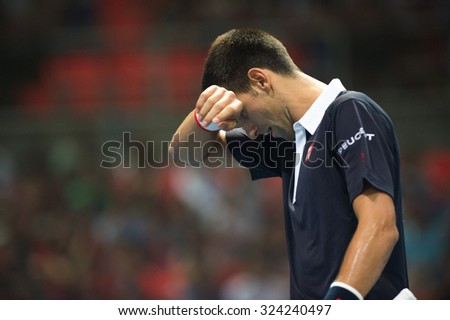 BANGKOK THAILAND OCTOBER 02:Novak Djokovic of Serbia in action during the Black to Thailand Nadal vs Djokovic exhibition match at Hua Mark Indoor Stadium on Oct 2, 2015 in,Thailand. - stock photo