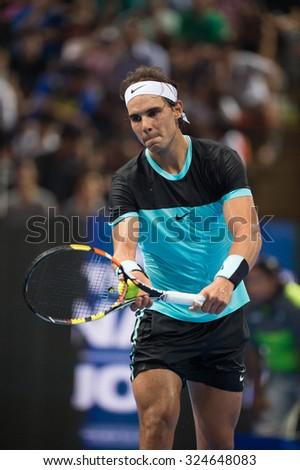 BANGKOK THAILAND OCTOBER 02:Rafael Nadal  of  Spain serves during the Black to Thailand Nadal vs Djokovic exhibition match at Hua Mark Indoor Stadium on Oct 2, 2015 in,Thailand. - stock photo